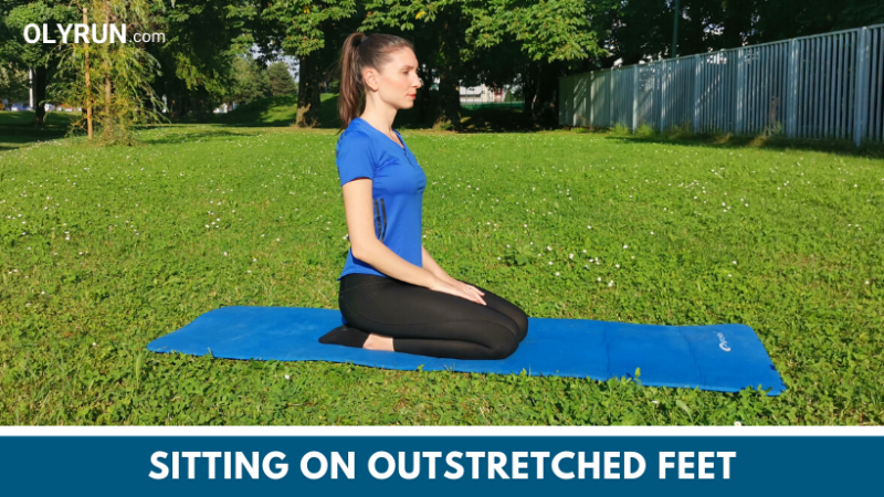 Sitting on outstretched feet in a kneeling position